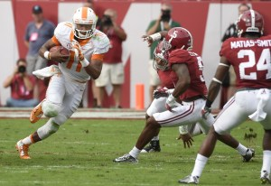 Oct 24, 2015; Tuscaloosa, AL, USA; Tennessee Volunteers quarterback Joshua Dobbs (11) scrambles up the middles against the Alabama Crimson Tide during the second quarter at Bryant-Denny Stadium. Mandatory Credit: John David Mercer-USA TODAY Sports