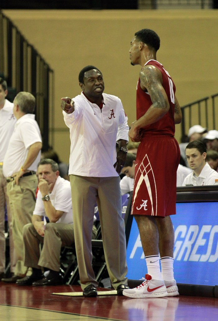 Nov 27, 2015; Kissimmee, FL, USA; Alabama Crimson Tide head coach Avery Johnson talks with forward Shannon Hale (11) against the Wichita State Shockers during the second half at HP Field House. Alabama Crimson Tide beat the Wichita State Shockers 64-60. Mandatory Credit: Kim Klement-USA TODAY Sports