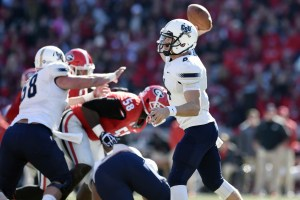 Nov 22, 2014; Athens, GA, USA; Charleston Southern Buccaneers quarterback Austin Brown (4) passes against the Georgia Bulldogs during the first quarter at Sanford Stadium. Mandatory Credit: Dale Zanine-USA TODAY Sports