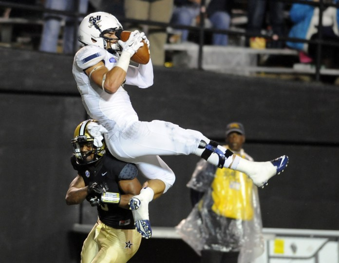 Oct 11, 2014; Nashville, TN, USA; Charleston Southern Buccaneers receiver Nathan Perera (3) makes a catch before being hit by Vanderbilt Commodores defensive back Torren McGaster (5) during the second half at Vanderbilt Stadium. Mandatory Credit: Christopher Hanewinckel-USA TODAY Sports