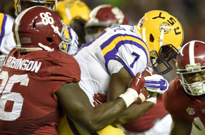 Nov 7, 2015; Tuscaloosa, AL, USA; LSU Tigers running back Leonard Fournette (7) is brought down by Alabama Crimson Tide defensive lineman A'Shawn Robinson (86) during the third quarter at Bryant-Denny Stadium. Mandatory Credit: John David Mercer-USA TODAY Sports