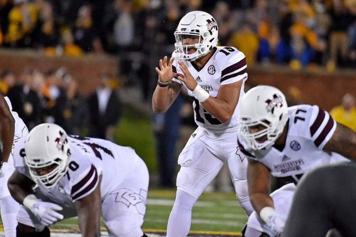 Nov 5, 2015; Columbia, MO, USA; Mississippi State Bulldogs quarterback Dak Prescott (15) in the game against the Missouri Tigers during the first half at Faurot Field. Mandatory Credit: Jasen Vinlove-USA TODAY Sports