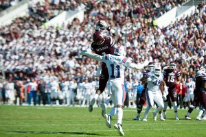 Oct 17, 2015; Starkville, MS, USA; Mississippi State Bulldogs wide receiver De'Runnya Wilson (1) catches the ball over Louisiana Tech Bulldogs safety Lloyd Grogan (11) during the first half at Davis Wade Stadium. Mandatory Credit: Joshua Lindsey-USA TODAY Sports