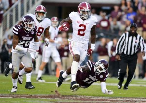 Nov 14, 2015; Starkville, MS, USA; Alabama Crimson Tide running back Derrick Henry (2) avoids a tackle by Mississippi State Bulldogs defensive back Kivon Coman (11) during a run that would result in a touchdown during the second quarter at Davis Wade Stadium. Mandatory Credit: Matt Bush-USA TODAY Sports