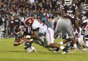 Nov 14, 2015; Starkville, MS, USA; Mississippi State Bulldogs quarterback Dak Prescott (15) is tackled by Alabama Crimson Tide defensive lineman Jonathan Allen (93) during the third quarter at Davis Wade Stadium. Alabama won 31-6. Mandatory Credit: Matt Bush-USA TODAY Sports
