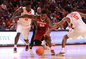 Dec 13, 2015; Clemson, SC, USA; Alabama Crimson Tide guard Retin Obasohan (32) battles for a loose ball against Clemson Tigers forward Jaron Blossomgame (5) and guard Ty Hudson (11) during the second half at Bon Secours Wellness Arena. The Crimson Tide won 51-50. Mandatory Credit: Dawson Powers-USA TODAY Sports