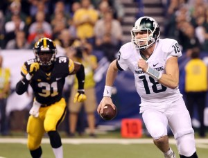 Dec 5, 2015; Indianapolis, IN, USA; Michigan State Spartans quarterback Connor Cook (18) runs the ball during the first half in the Big Ten Conference football championship game against the Iowa Hawkeyes at Lucas Oil Stadium. Mandatory Credit: Aaron Doster-USA TODAY Sports