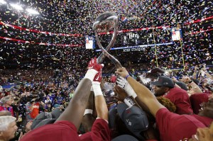 Dec 31, 2015; Arlington, TX, USA; Alabama Crimson Tide players hoist the Cotton Bowl championship trophy after defeating the Michigan State Spartans in the 2015 CFP semifinal at the Cotton Bowl at AT&T Stadium. Mandatory Credit: Tim Heitman-USA TODAY Sports