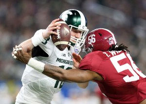 Dec 31, 2015; Arlington, TX, USA; Michigan State Spartans quarterback Connor Cook (18) is pressured by Alabama Crimson Tide linebacker Tim Williams (56) in the third quarter in the 2015 CFP semifinal at the Cotton Bowl at AT&T Stadium. Mandatory Credit: Matthew Emmons-USA TODAY Sports