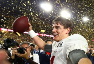 Jan 11, 2016; Glendale, AZ, USA; Alabama Crimson Tide quarterback Jake Coker (14) celebrates on the field after defeating the Clemson Tigers in the 2016 CFP National Championship at University of Phoenix Stadium. Mandatory Credit: Mark J. Rebilas-USA TODAY Sports