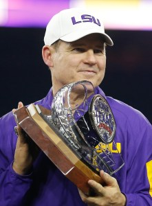 Dec 29, 2015; Houston, TX, USA; LSU Tigers head coach Les Miles holds the Texas Bowl trophy after LSU defeated the Texas Tech Red Raiders at NRG Stadium. LSU won 56 to 27. Mandatory Credit: Thomas B. Shea-USA TODAY Sports