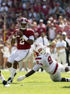 Sep 10, 2016; Tuscaloosa, AL, USA; Alabama Crimson Tide quarterback Jalen Hurts (2) looks downfield as Western Kentucky Hilltoppers defensive lineman Omarius Bryant (9) puts the pressure on him at Bryant-Denny Stadium. Mandatory Credit: Marvin Gentry-USA TODAY Sports