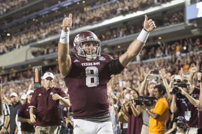 Oct 8, 2016; College Station, TX, USA; Texas A&M Aggies quarterback Trevor Knight (8) celebrates after scoring the game winning touchdown during the second overtime against the Tennessee Volunteers at Kyle Field. The Aggies defeated the Volunteers 45-38 in overtime. Mandatory Credit: Jerome Miron-USA TODAY Sports
