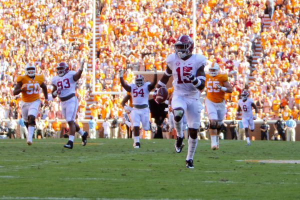 Oct 15, 2016; Knoxville, TN, USA; Alabama Crimson Tide defensive back Ronnie Harrison (15) returns an interception for a touchdown against the Tennessee Volunteers during the first half at Neyland Stadium. Mandatory Credit: Randy Sartin-USA TODAY Sports