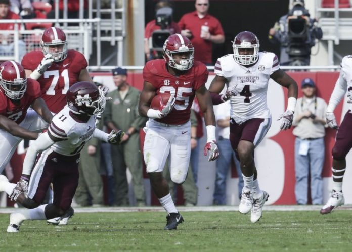 Nov 12, 2016; Tuscaloosa, AL, USA; Alabama Crimson Tide running back Joshua Jacobs (25) carries the ball as Mississippi State Bulldogs defensive back Kivon Coman (11) reaches for him at Bryant-Denny Stadium. The Tide defeated the Bulldogs 51-3. Mandatory Credit: Marvin Gentry-USA TODAY Sports