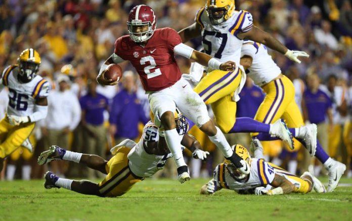 Nov 5, 2016; Baton Rouge, LA, USA; Alabama Crimson Tide quarterback Jalen Hurts (2) carries for a 21 yard touchdown against the LSU Tigers during the fourth quarter at Tiger Stadium. Mandatory Credit: John David Mercer-USA TODAY Sports