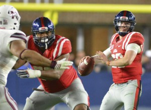 Nov 26, 2016; Oxford, MS, USA; Mississippi Rebels quarterback Shea Patterson (20) attempts a pass during the second half of the game against the Mississippi State Bulldogs at Vaught-Hemingway Stadium. Mississippi State won 55-20 Mandatory Credit: Matt Bush-USA TODAY Sports