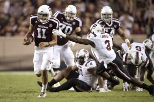 Sep 30, 2017; College Station, TX, USA; Texas A&M Aggies quarterback Kellen Mond (11) eludes South Carolina Gamecocks defensive back Chris Lammons (3) during the second half at Kyle Field. The Aggies defeat the Gamecocks 24-17. Mandatory Credit: Jerome Miron-USA TODAY Sports