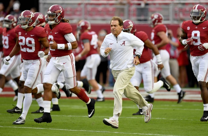 Oct 14, 2017; Tuscaloosa, AL, USA; Alabama Crimson Tide head coach Nick Saban leads his players out to the field prior to the start of their game against the Arkansas Razorbacks at Bryant-Denny Stadium. Mandatory Credit: John David Mercer-USA TODAY Sports
