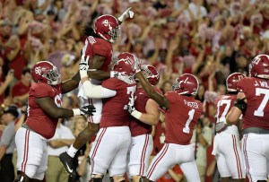 Sep 30, 2017; Tuscaloosa, AL, USA; Alabama Crimson Tide running back Bo Scarbrough (9) celebrates his touchdown in the end zone with offensive lineman Matt Womack (77) against the Mississippi Rebels during the first quarter at Bryant-Denny Stadium. Mandatory Credit: John David Mercer-USA TODAY Sports