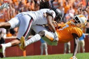 Oct 14, 2017; Knoxville, TN, USA; South Carolina Gamecocks defensive back JaMarcus King (7) tackles Tennessee Volunteers wide receiver Brandon Johnson (7) during the second half at Neyland Stadium. South Carolina won 15 to 9. Mandatory Credit: Randy Sartin-USA TODAY Sports