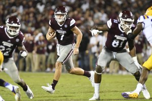 Sep 16, 2017; Starkville, MS, USA; Mississippi State Bulldogs quarterback Nick Fitzgerald (7) runs the ball against the LSU Tigers during the fourth quarter at Davis Wade Stadium. Mandatory Credit: Matt Bush-USA TODAY Sports