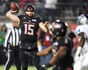 Dec 16, 2017; Montgomery, AL, USA; Arkansas State Red Wolves quarterback Justice Hansen (15) looks to throw the ball to running back Warren Wand (6) in the fourth quarter against the Middle Tennessee Blue Raiders in the 2017 Camellia Bowl at Cramton Bowl. Mandatory Credit: RVR Photos-USA TODAY Sports