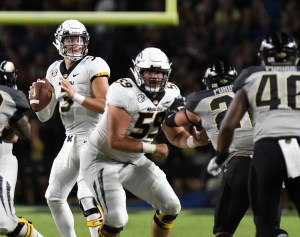 Missouri Tigers quarterback Drew Lock (3) drops back to pass in the first half against the Purdue Boilermakers at Ross-Ade Stadium. Thomas J. Russo-USA TODAY Sports