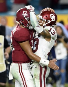 Dec 29, 2018; Miami Gardens, FL, USA; Alabama Crimson Tide quarterback Tua Tagovailoa (13) and Oklahoma Sooners cornerback Tre Norwood (13) hug after the 2018 Orange Bowl college football playoff semifinal game at Hard Rock Stadium. Mandatory Credit: John David Mercer-USA TODAY Sports