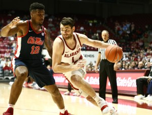 Jan 22, 2019; Tuscaloosa, AL, USA; Alabama Crimson Tide guard Riley Norris (1) drives to the basket against Mississippi Rebels forward Bruce Stevens (12) during the second half at Coleman Coliseum. Mandatory Credit: Marvin Gentry-USA TODAY Sports