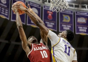 Jan 8, 2019; Baton Rouge, LA, USA; LSU Tigers forward Kavell Bigby-Williams (11) blocks a shot by Alabama Crimson Tide guard Herbert Jones (10) during the first half at the Maravich Assembly Center. Mandatory Credit: Derick E. Hingle-USA TODAY Sports