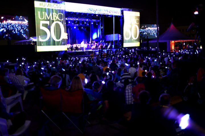 A sea of Retrievers wearing glowing bracelets at the festival finale.