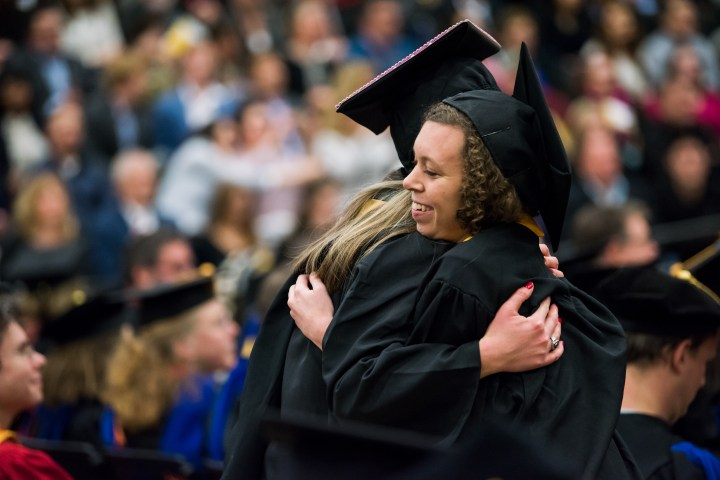 UMBC student and faculty exchanged hugs during Winter Commencement.