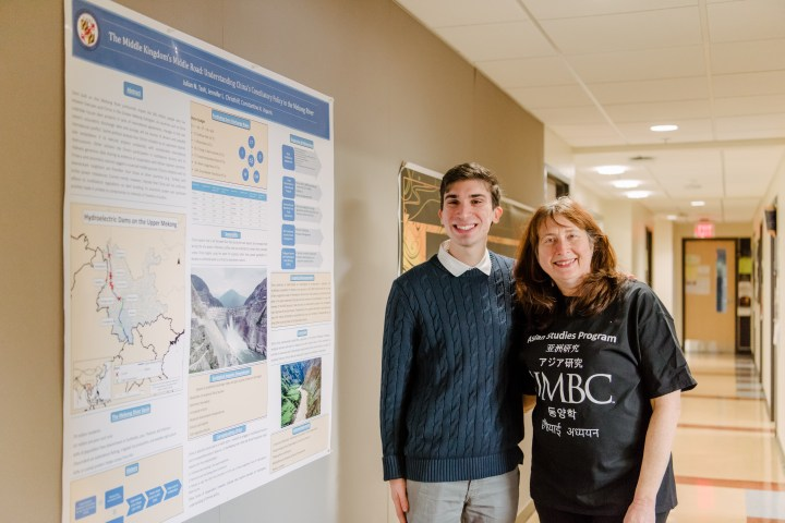Student and mentor at research poster
