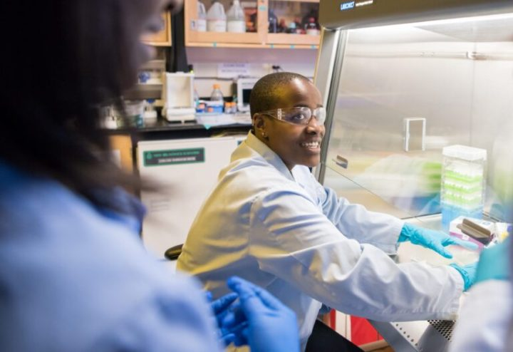 Naomi Mburu '18, UMBC's first Rhodes Scholar, works in the lab with a faculty mentor.