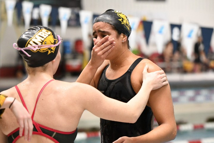 An emotional Hania Moro celebrates with teammates after breaking a school record. Photo courtesy of Colleen Hummel.
