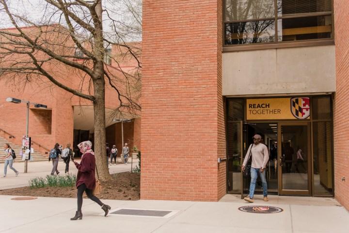 New branded imagery adorns campus doorways.