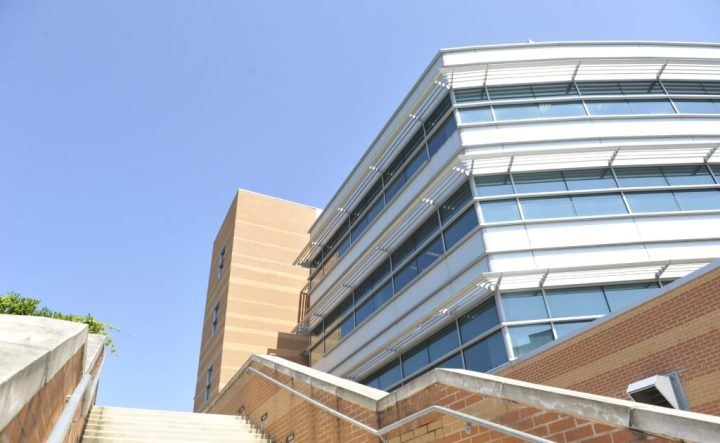 Metal, glass and brick building. Stairs  are in the foreground.