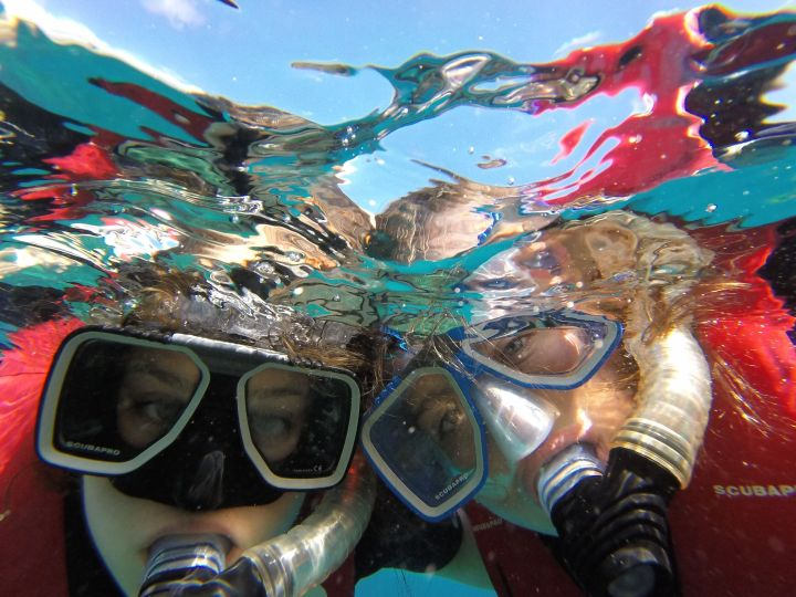 Kempske (right) snorkling with her sister at the Great Barrier Reef in Australia.