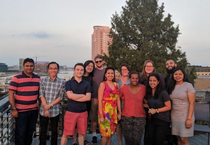 group photo on a balcony