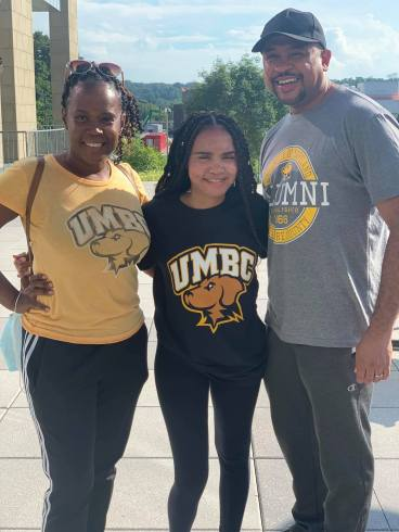 Parents and daughter in UMBC clothing
