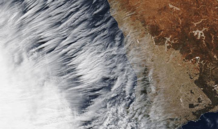satellite image of clouds along a coastline