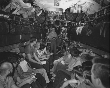 Church service in the torpedo room of the USS Bullhead while on patrol in the Pacific, 1945