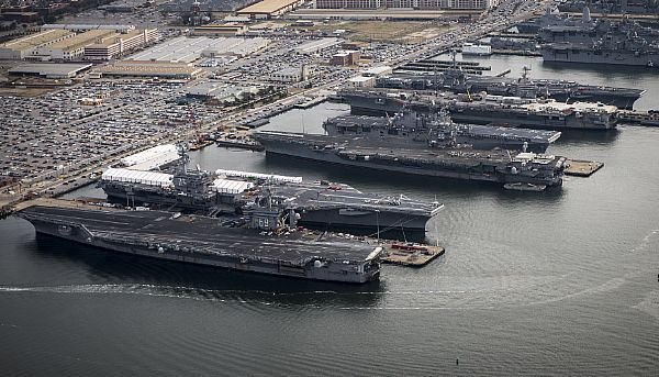 That's the USS Dwight D. Eisenhower (CVN 69), USS George H.W. Bush (CVN 77), USS Enterprise (CVN 65), USS Harry S. Truman (CVN 75), and USS Abraham Lincoln (CVN 72), all lined up at the dock at the naval station: Norfolk.