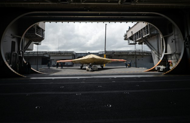 An X-47B Unmanned Combat Air System (UCAS) demonstrator sits on an aircraft elevator of the aircraft carrier USS George H.W. Bush (CVN-77) on May 6, 2013. US Navy Photo