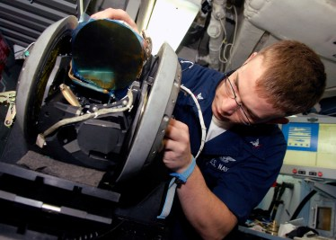 A sailor repairs a forward looking infrared pod (AT FLIR) in 2007. US Navy Photo