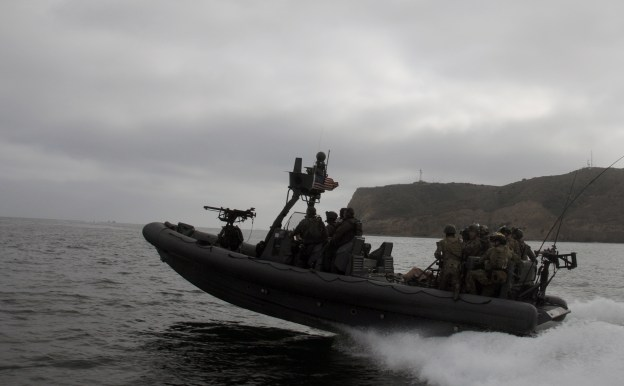 Navy SEALs assigned to a west coast based SEAL Team and Special Warfare Combatant-craft Crewmen (SWCC) from Naval Special Warfare Boat Team (SBT) on May 23, 2012.