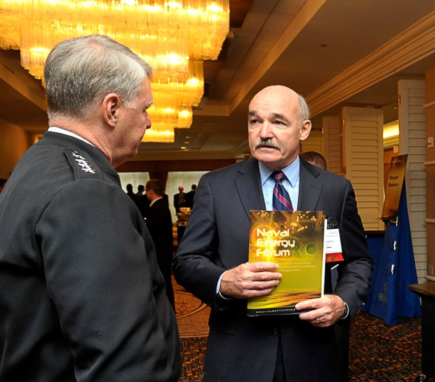 Then-Chief of Naval Operations (CNO) Adm. Gary Roughead, left, speaks with panelist retired Vice Adm. Dennis McGinn in 2009. US Navy Photo