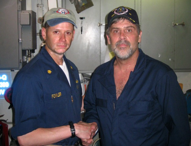 Maersk-Alabama Capt. Richard Phillips, stands alongside Lt. Cmdr. David Fowler, commanding officer of USS Bainbridge (DDG 96) after being rescued by US Naval Forces off the coast of Somalia on April 12, 2009. US Navy Photo