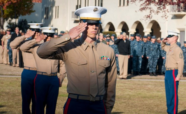 Capt. Michael DiFelice salutes during the playing of the national anthem at the 238th US Marine Corps Birthday. US Navy Photo